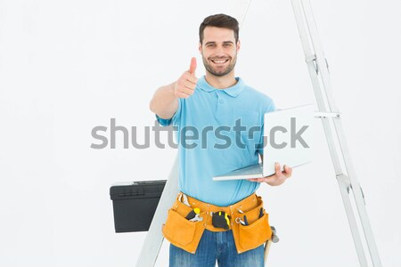 Happy courier man giving envelops Stock photo © wavebreak_media
