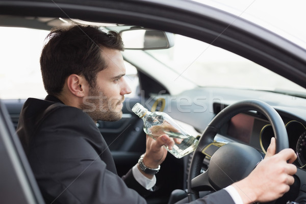 Young businessman driving while drunk Stock photo © wavebreak_media