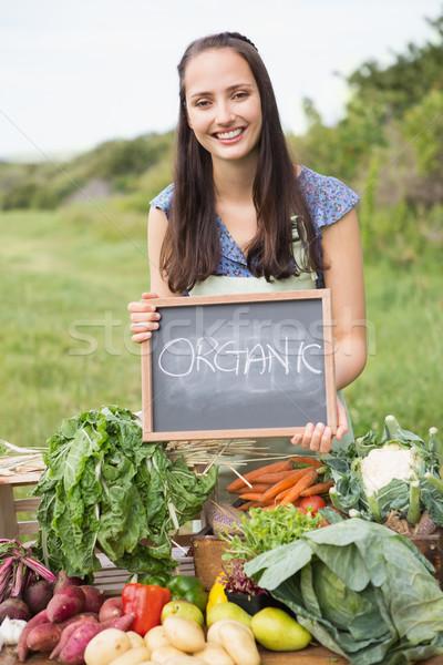 Pretty brunette selling organic vegetables Stock photo © wavebreak_media