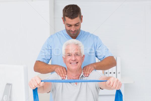 Idős beteg testmozgás férfi ellenállás zenekar Stock fotó © wavebreak_media
