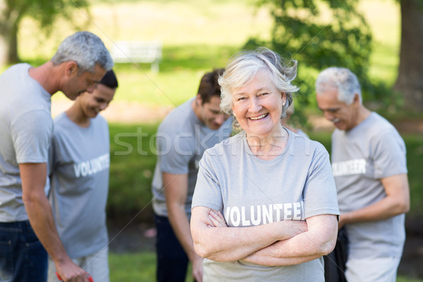 Happy volunteer grandmother smiling at camera Stock photo © wavebreak_media