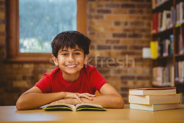 Aranyos fiú olvas könyv könyvtár portré Stock fotó © wavebreak_media