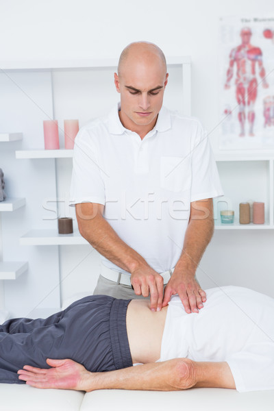 Physiotherapist doing back massage to his patient Stock photo © wavebreak_media