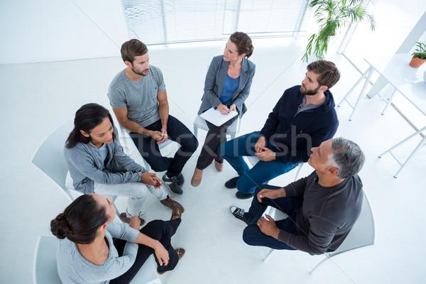 Groep therapie vergadering cirkel hoek Stockfoto © wavebreak_media