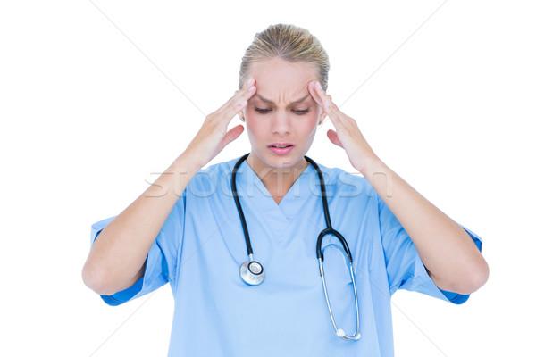 Femminile medico depresso bianco muro Foto d'archivio © wavebreak_media