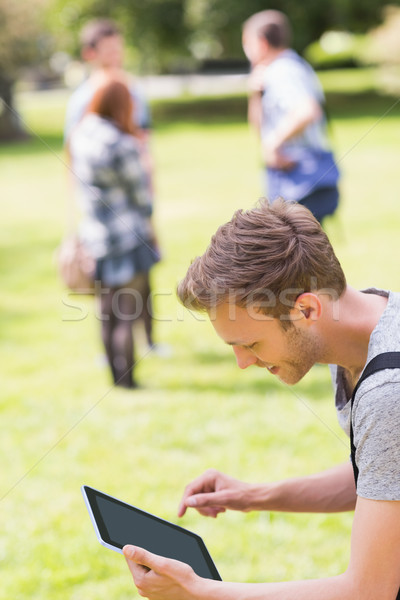 Handsome student studying outside on campus Stock photo © wavebreak_media