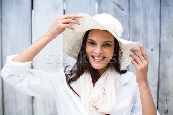 Smiling beautiful brunette wearing straw hat and looking at came Stock photo © wavebreak_media