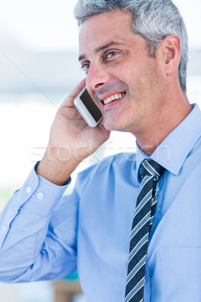 Happy businessman having a phone call  Stock photo © wavebreak_media
