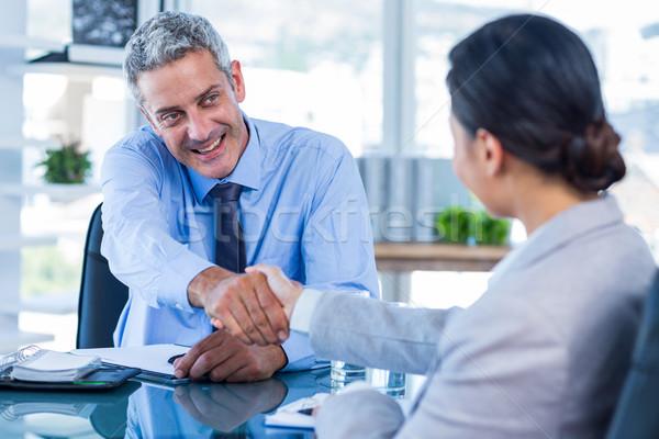 Boldog üzletemberek kézfogás iroda nő férfi Stock fotó © wavebreak_media