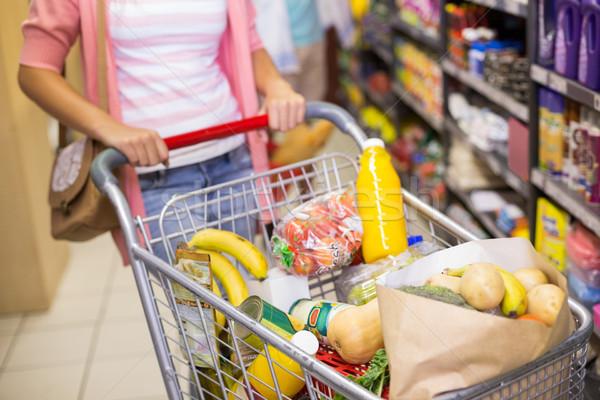 Fiatal nő vásárol termékek áruház férfi piac Stock fotó © wavebreak_media