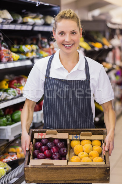Portrait of a smiling blonde worker holding a box with vegetable Stock photo © wavebreak_media