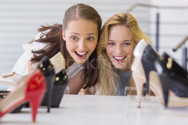 2 興奮した 女性 見える 靴 ストックフォト © wavebreak_media