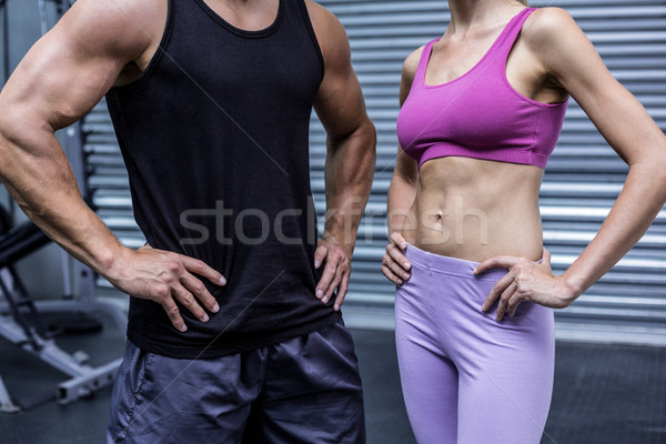 Muscular Pareja manos caderas crossfit gimnasio Foto stock © wavebreak_media