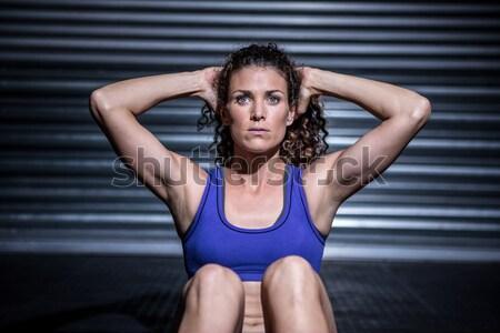 Portrait of muscular man doing push-ups Stock photo © wavebreak_media