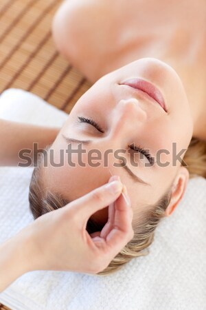 Hands cleaning woman face with cotton swabs Stock photo © wavebreak_media