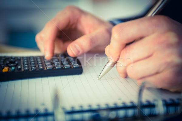 üzletember számológép ír iroda pénzügy profi Stock fotó © wavebreak_media