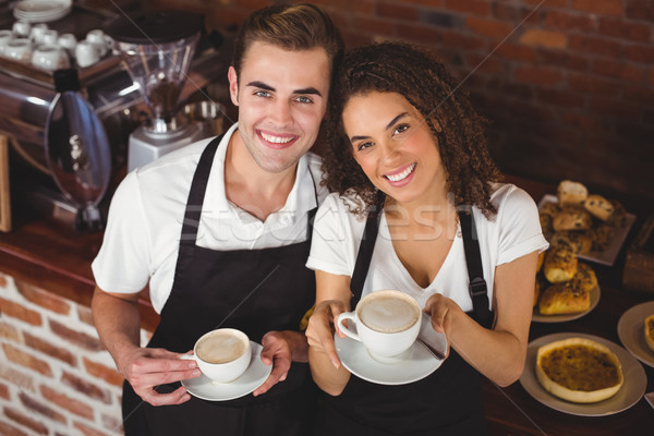 Sonriendo camarero camarera taza café Foto stock © wavebreak_media