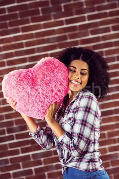 çekici genç kadın yastık kırmızı tuğla Stok fotoğraf © wavebreak_media