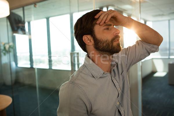 Triste empresario vidrio oficina cuaderno Foto stock © wavebreak_media