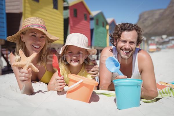 Stock fotó: Portré · boldog · család · pléd · tengerpart · együtt · napos · idő