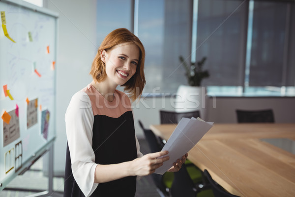 Portrait of smiling executive holding documents Stock photo © wavebreak_media