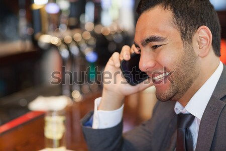 Smiling waitress talking on mobile phone Stock photo © wavebreak_media