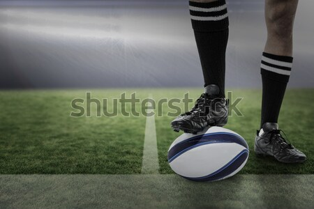 Low section of player with leg on rugby ball Stock photo © wavebreak_media
