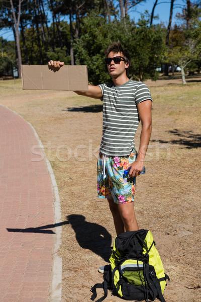 Man hitchhiking at roadside Stock photo © wavebreak_media