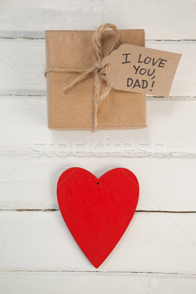 Gift box with text by heart shape on table Stock photo © wavebreak_media
