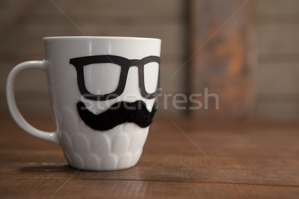 Beyaz kupa bıyık gözlük tablo Stok fotoğraf © wavebreak_media