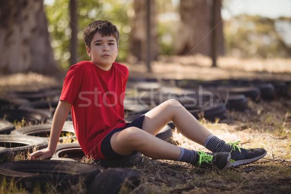 Portret chłopca relaks opony boot Zdjęcia stock © wavebreak_media