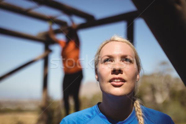 Figyelmes nő áll csizma tábor akadályfutás Stock fotó © wavebreak_media