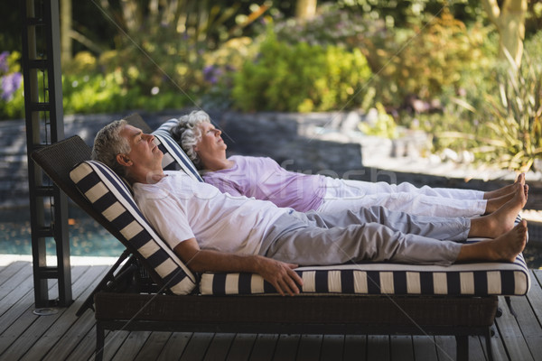 Full length of senior couple resting together on lounge chairs Stock photo © wavebreak_media