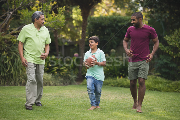 Jongen vader grootvader park spelen rugby Stockfoto © wavebreak_media