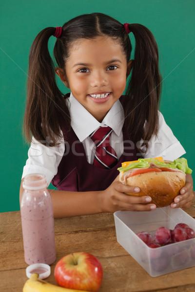 школьница сэндвич портрет ребенка фрукты окна Сток-фото © wavebreak_media