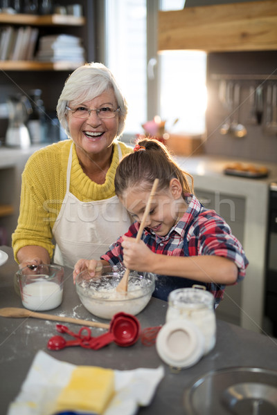 Granddaughter mixing flour in a bowl Stock photo © wavebreak_media