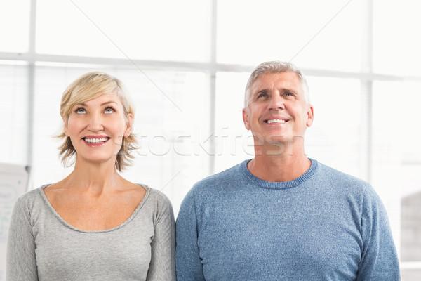 Sorridente negócio colegas olhando acima escritório Foto stock © wavebreak_media
