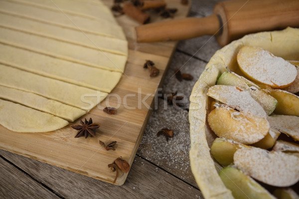 High angle view of pastry dough stripes on cutting board with apple in baking pan Stock photo © wavebreak_media