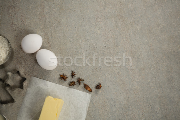 overhead view of eggs and spices by butter Stock photo © wavebreak_media