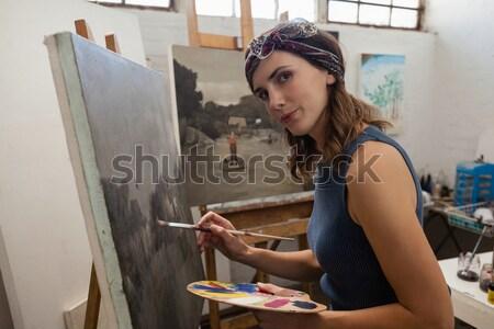 Kadın boyama tuval çizim sınıf portre Stok fotoğraf © wavebreak_media