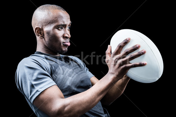 Rugby player looking away while throwing ball Stock photo © wavebreak_media