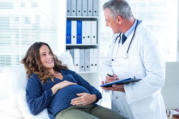 Doctor examining pregnant woman in clinic Stock photo © wavebreak_media