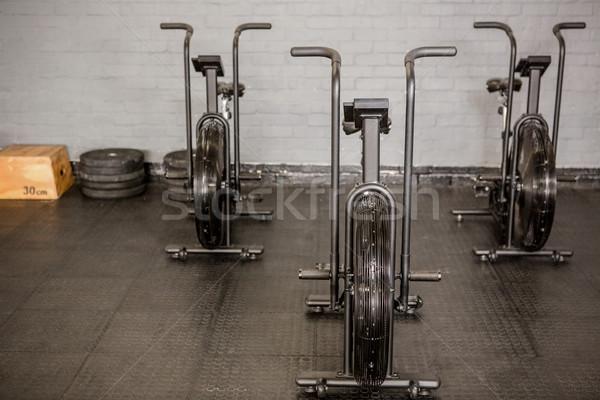 осуществлять цикл оборудование спортзал фитнес велосипед Сток-фото © wavebreak_media