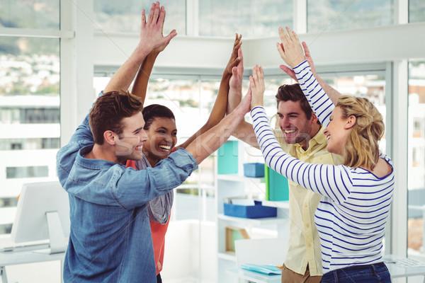 счастливым Creative команда высокий другой случайный Сток-фото © wavebreak_media