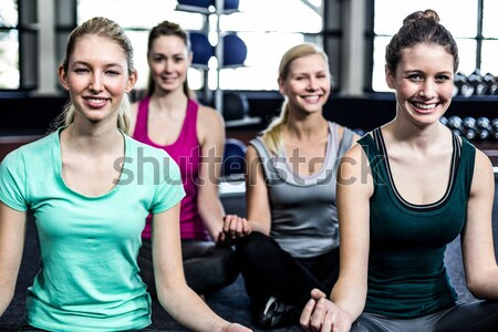 Women discussing her performance on clipboard with trainer  Stock photo © wavebreak_media