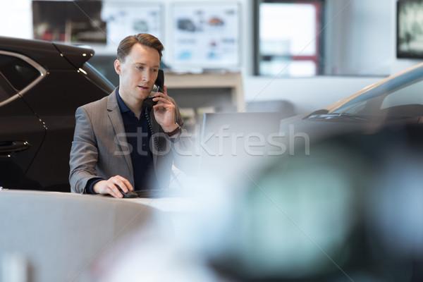 Car salesperson talking on landline phone Stock photo © wavebreak_media