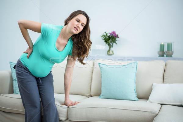 Femme enceinte salon femme maison santé Photo stock © wavebreak_media