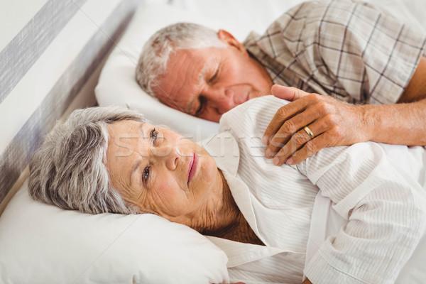 Kıdemli kadın uyanık yatak adam uyku Stok fotoğraf © wavebreak_media