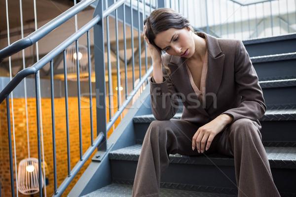 Jeunes femme d'affaires séance escalier fatigué bureau Photo stock © wavebreak_media