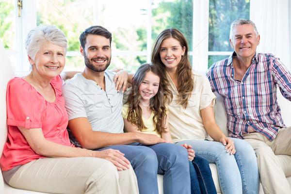 Portrait of happy family sitting on sofa  Stock photo © wavebreak_media